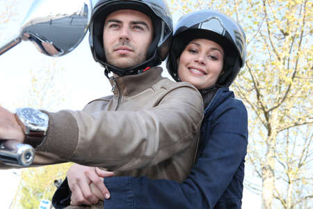 Couple on motorcycle photo