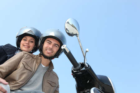 two people on scooter photo