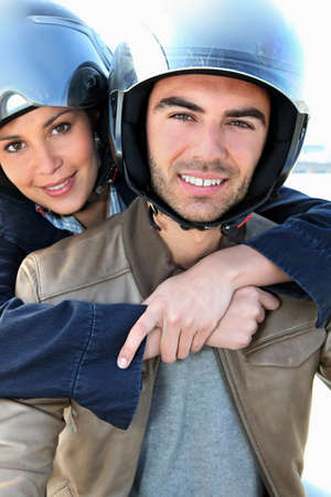 Couple on a scooter photo