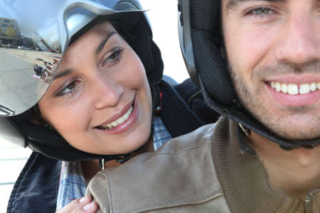 Couple riding scooter photo