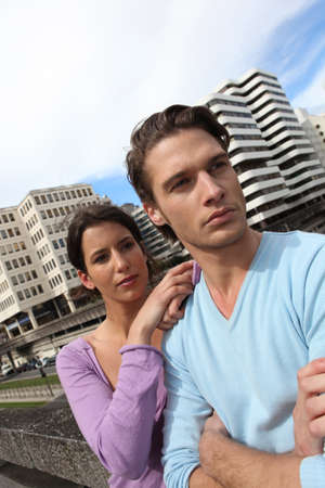 Couple in front of tall buildings area photo
