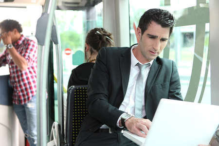 young man in public transportation photo
