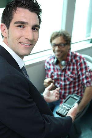 train ticket: Man checking tickets on a train