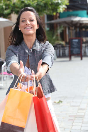 ebullient: dark-haired lady with shopping bags