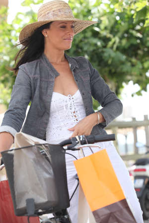 Woman on bike with shopping bags photo