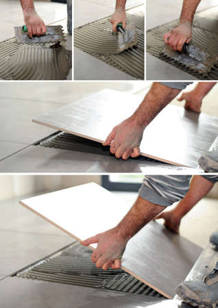 handyman spreading glue on the floor photo