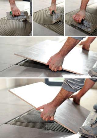 handyman spreading glue on the floor photo