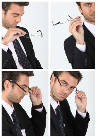 a manager taking his glasses Stock Photo - 14023276