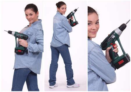 Woman operating a screwdriver photo