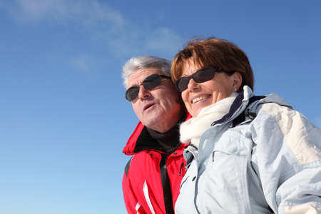 Retired couple in skiwear photo