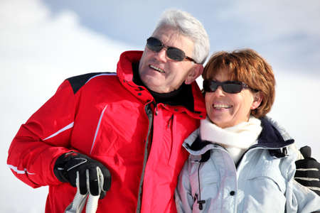 winter jacket: old couple skiing