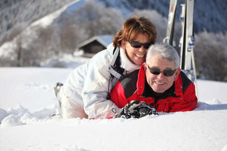 tourist resort: Older couple playing in the snow Stock Photo