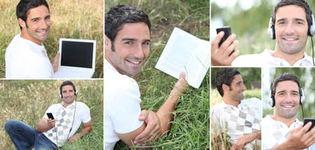 Man listening to music outdoors via laptop photo
