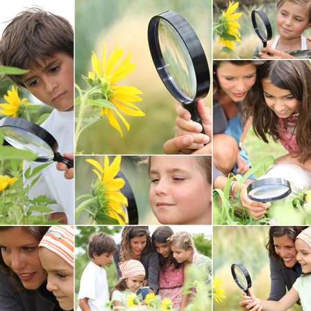 Family with magnifying glass nature spotting photo