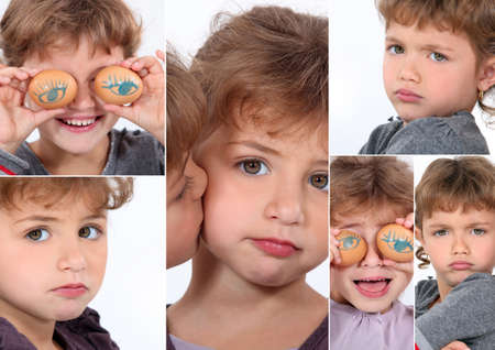 Little girl covering eyes with eggs photo