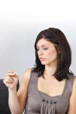 Woman taking pregnancy test photo