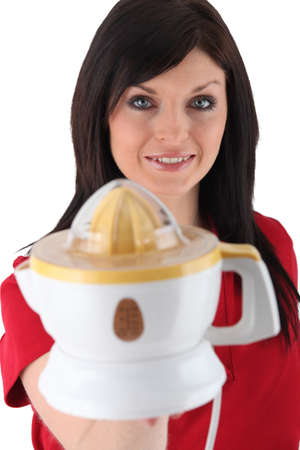 Woman holding an electric lemon squeezer photo