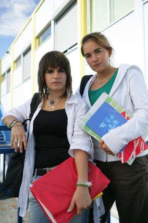 studygroup: Two teenage girls going to their next lesson