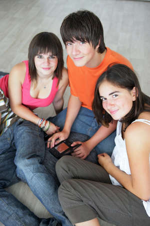 maneuvering: Teens with console