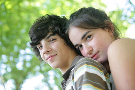 Teenage boy and girl outdoors photo