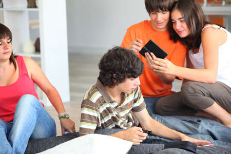 hang out: Teenage friends hanging out at home