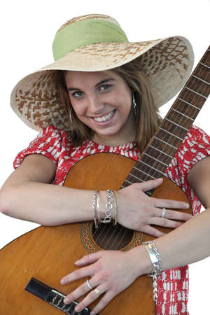 Cheerful woman holding a guitar photo