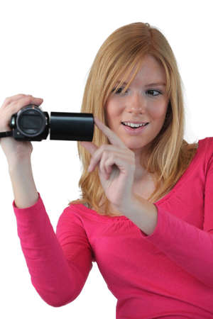 ccd camera: Woman holding compact video camera