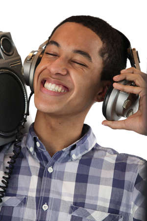 Boy listening to music on his headphones photo