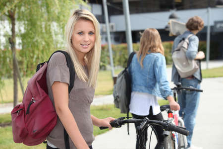 beautiful girl go to the university with her friends photo