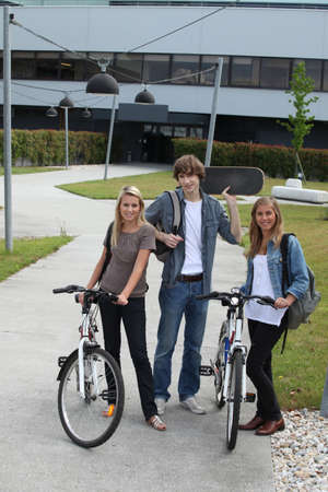 Young people with bicycles and skateboard photo