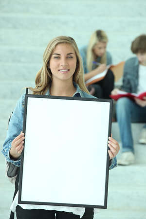 Student and white placard photo