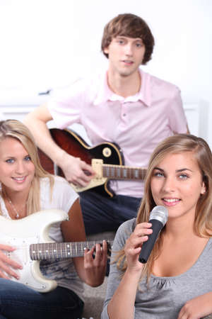 teenagers playing music instruments photo