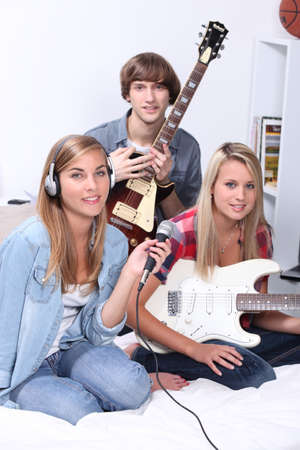 Teenagers making music in a bedroom photo