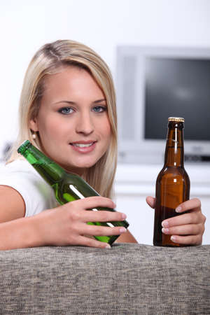 Teen with two bottles of beer photo