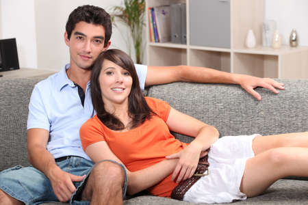 Young couple sitting on a sofa photo