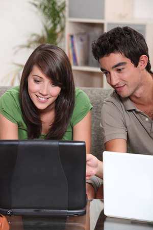 Young couple with their laptop computers photo