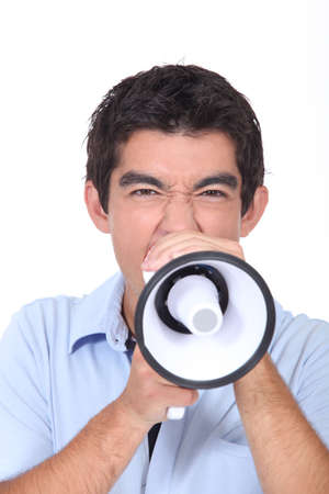 Teenager shouting into loud speaker Stock Photo - 14101602