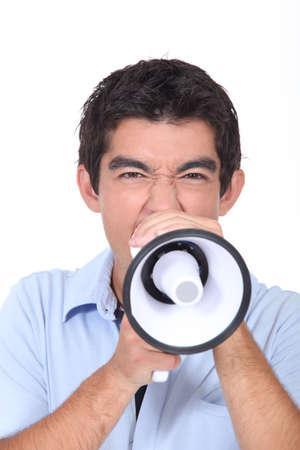 Teenager shouting into loud speaker Stock Photo - 14101602