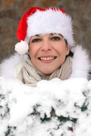 Woman wearing a festive hat whilst in snow Stock Photo - 14101111