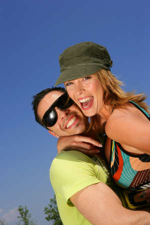 presentiment: Young couple laughing against a blue sky