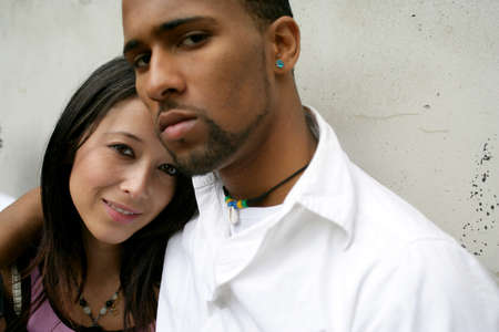 mixed race ethnicity: Serious young urban couple