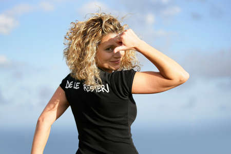 Young blond woman showing her t-shirt Stock Photo - 14102074