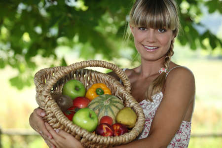 Woman holding wicker basket photo