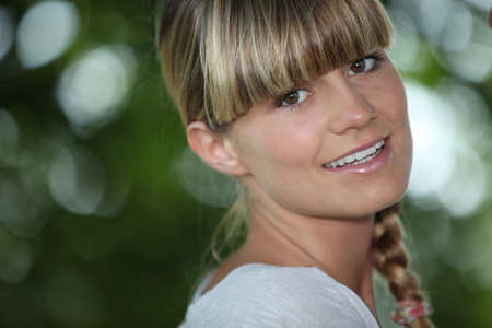 Young woman with a blunt fringe outdoors photo