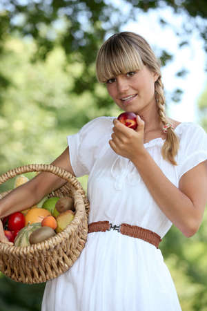 landlady: Blond woman carrying fruit basket