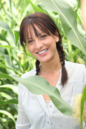 Woman in a maize field photo