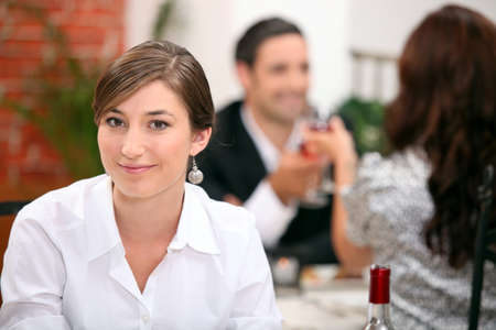 dangle: Woman eating in a restaurant