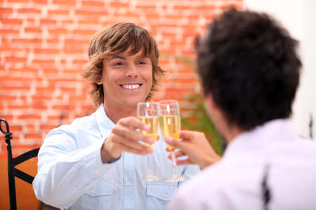 Men with a glass of champagne Stock Photo - 14101795