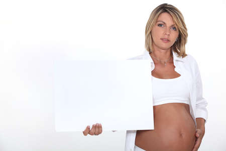 naked belly: Pregnant woman with white poster