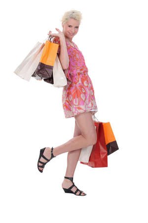 look pleased: Woman with shopping bags